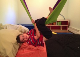 Cloth swings and climbing equipment help children work on play, balance, and other gross motor skills.